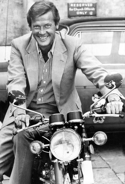Roger Moore on a motorbike 1973