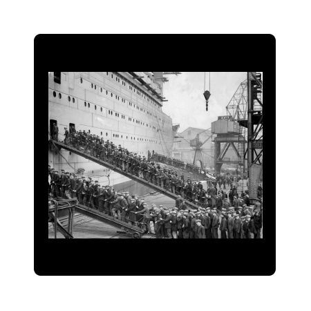 Transatlantic liner Queen Mary - hundreds of workers going aboard after lunch in 1935 in the Glasgow shipyard where the ship is being fitted out
