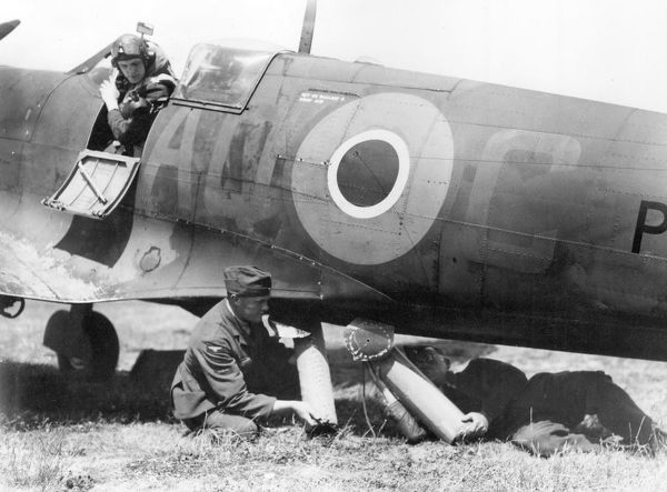 RAF ground crew loading air sea rescue equipment into the belly of a Spitfire 1943