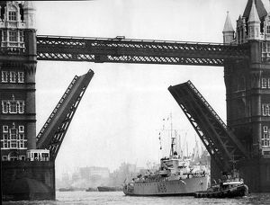 london/hms cheerful royal navy minesweeper going tower